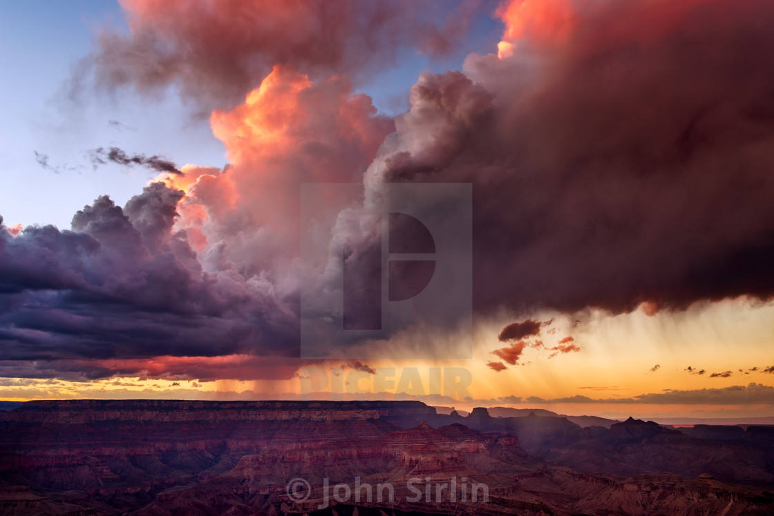 """Dramatic storm clouds over the Grand Canyon at sunset"" stock image"