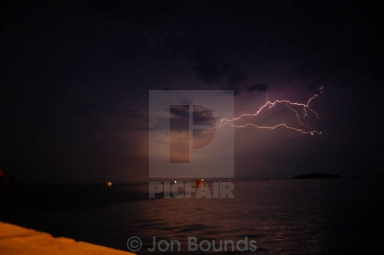 """Lightning over harbour"" stock image"