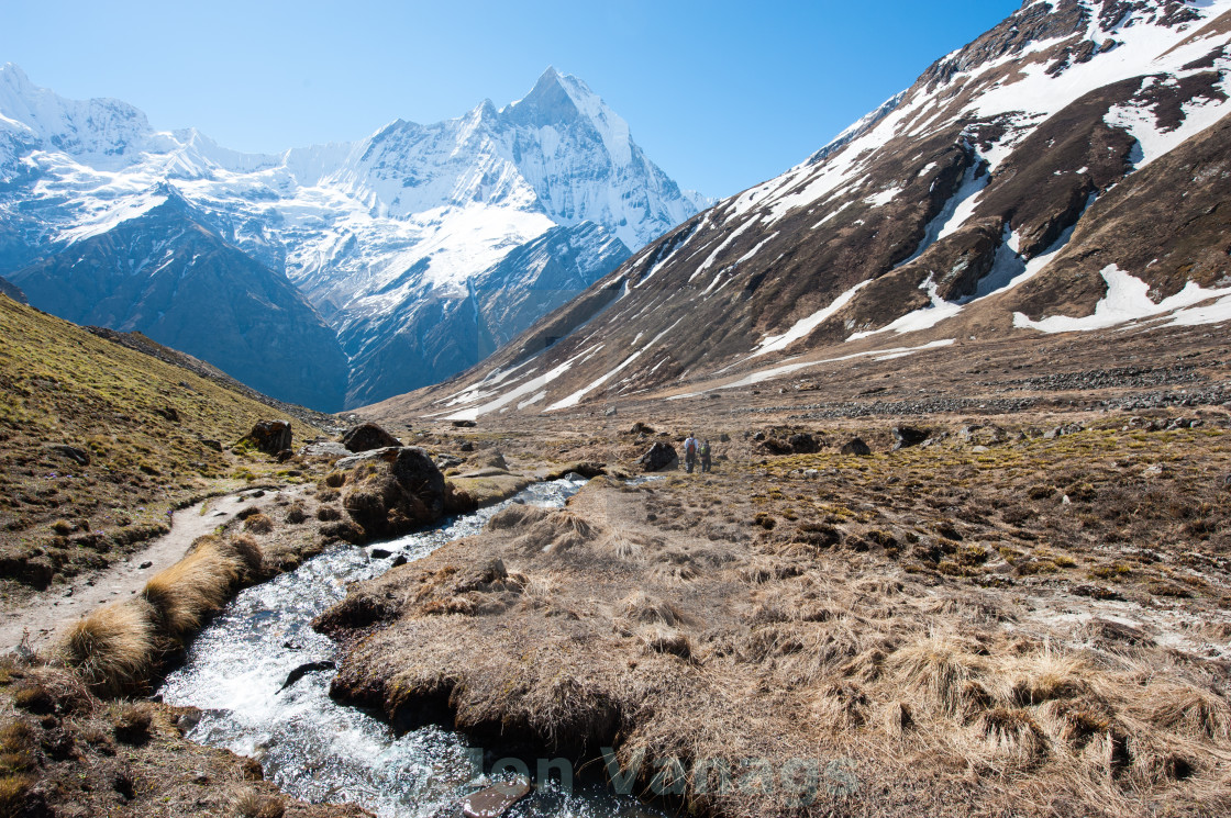 """Stream with Fishtail Mountain in the background, AnnaPurna, Himalayas, Nepal"" stock image"