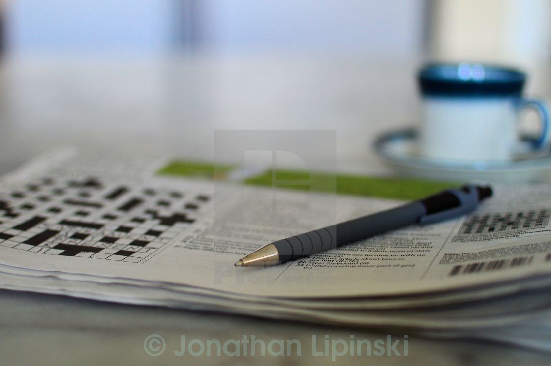 """""""The Times Crossword with coffee cup and pen"""" stock image"""