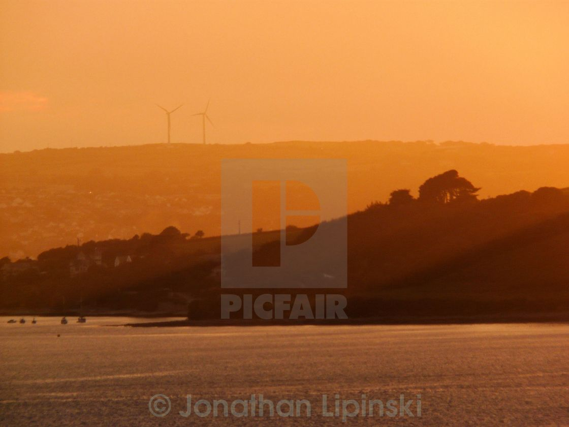 """""""Sunset at St Mawes with wind turbines in the background"""" stock image"""