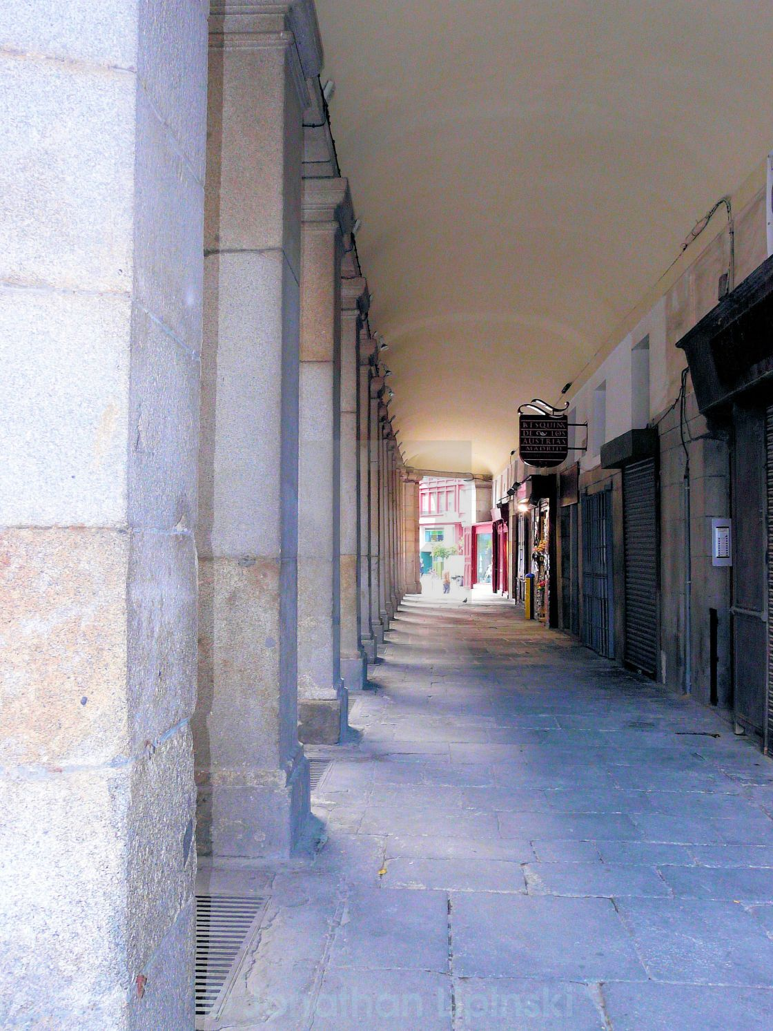 """A covered arcade in Madrid"" stock image"