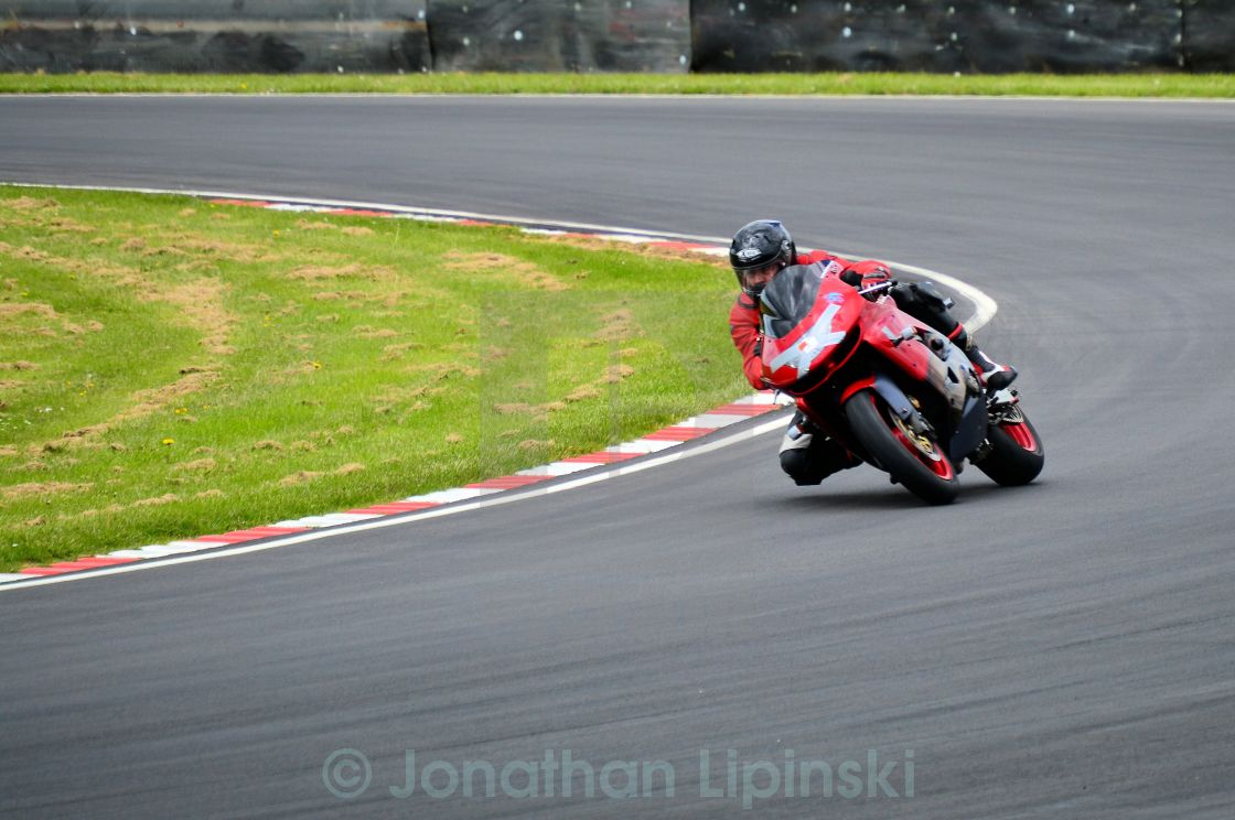 """A racing motorcycle cornering"" stock image"