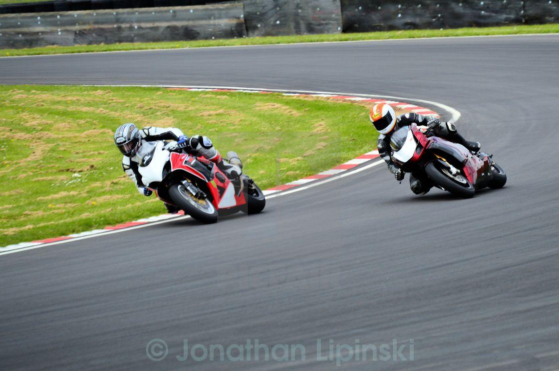"""Two Racing Motorcycles cornering hard"" stock image"