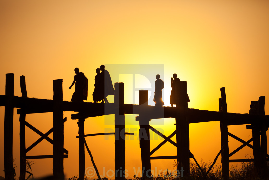 """A group of Buddhists on a bridge"" stock image"