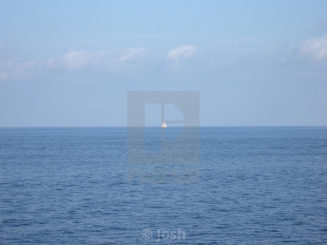 """""""Lone Sail Boat at Sea"""" stock image"""