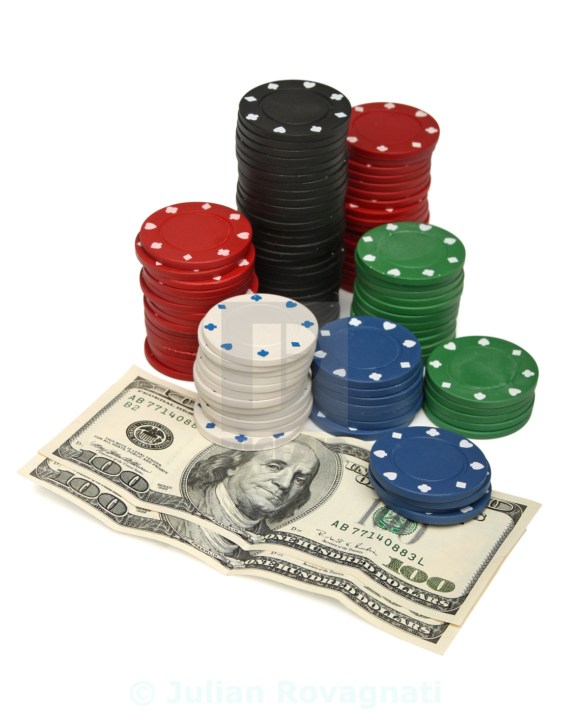 """""""Gambling chips and dollar bills over white"""" stock image"""