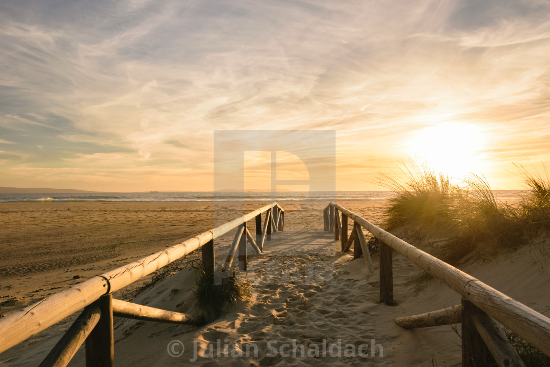 """Path on sand at sunset, Tarifa, Spain"" stock image"