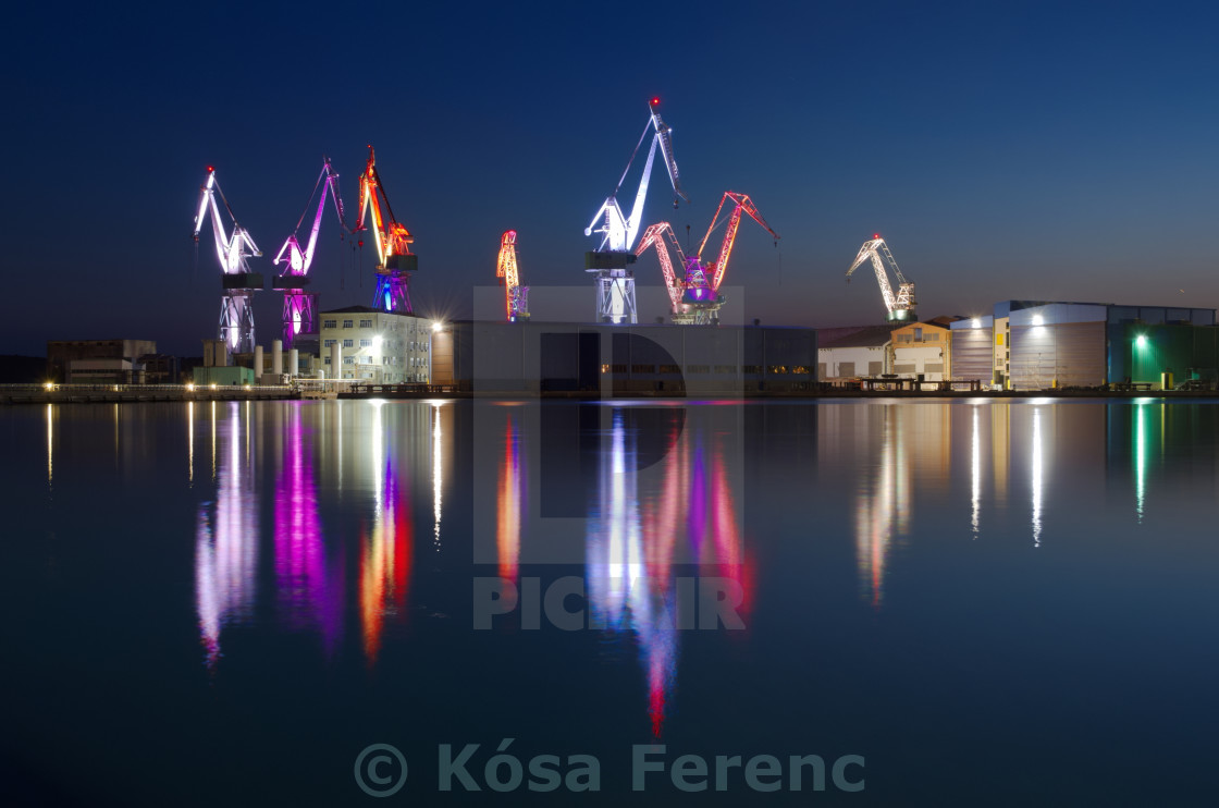 """Dock Cranes in Pula at Night"" stock image"