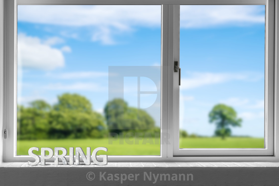 """""""Decor spring in a window sill with a view to a green garden"""" stock image"""