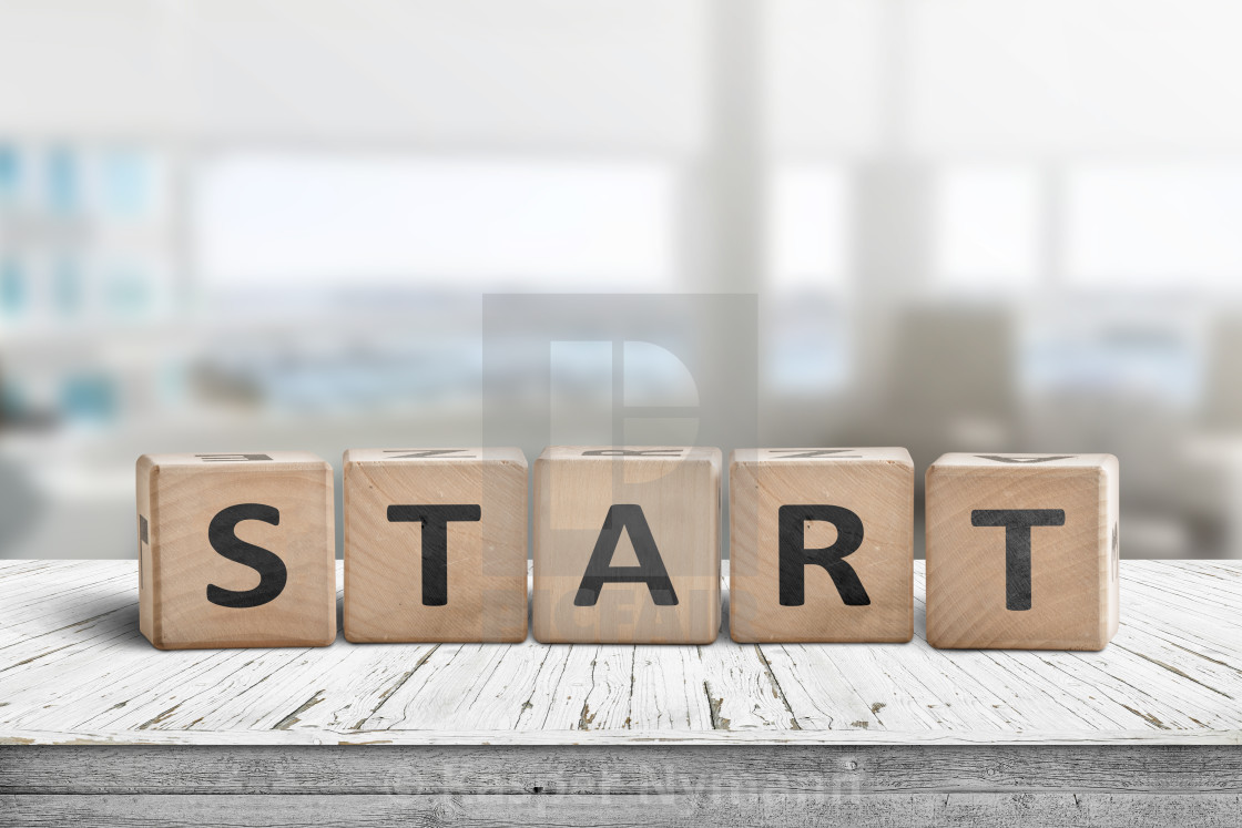 """""""Start sign in a bright office on a wooden table"""" stock image"""