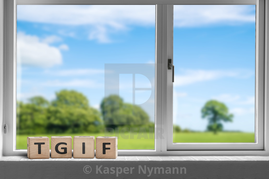 """""""TGIF weekend sign in a white window"""" stock image"""