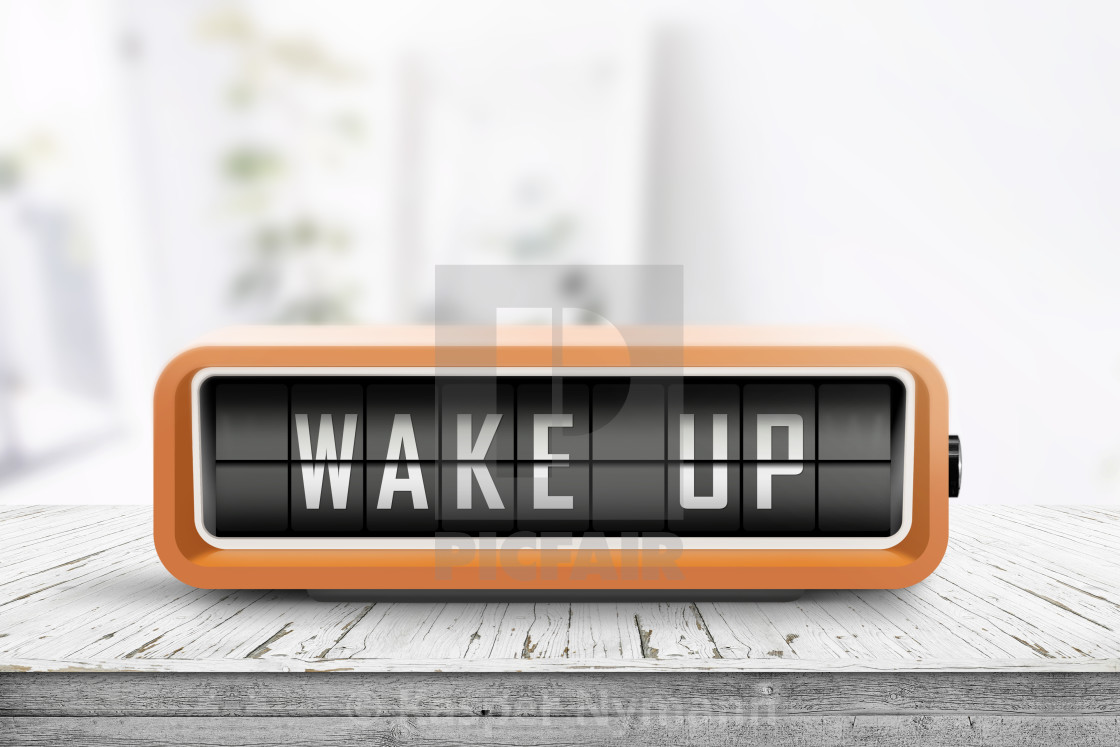 """""""Wake up alarm clock on a table in a bright room"""" stock image"""