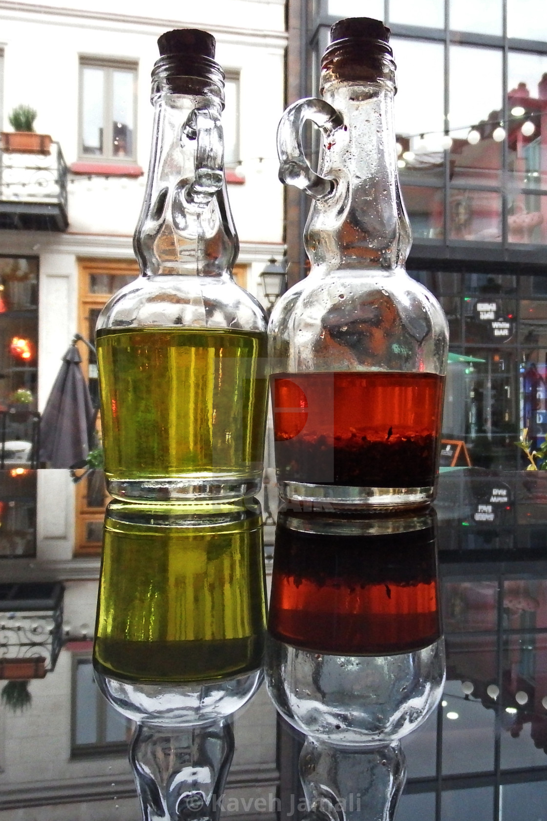 """Red and Green Olive Oil Bottles"" stock image"