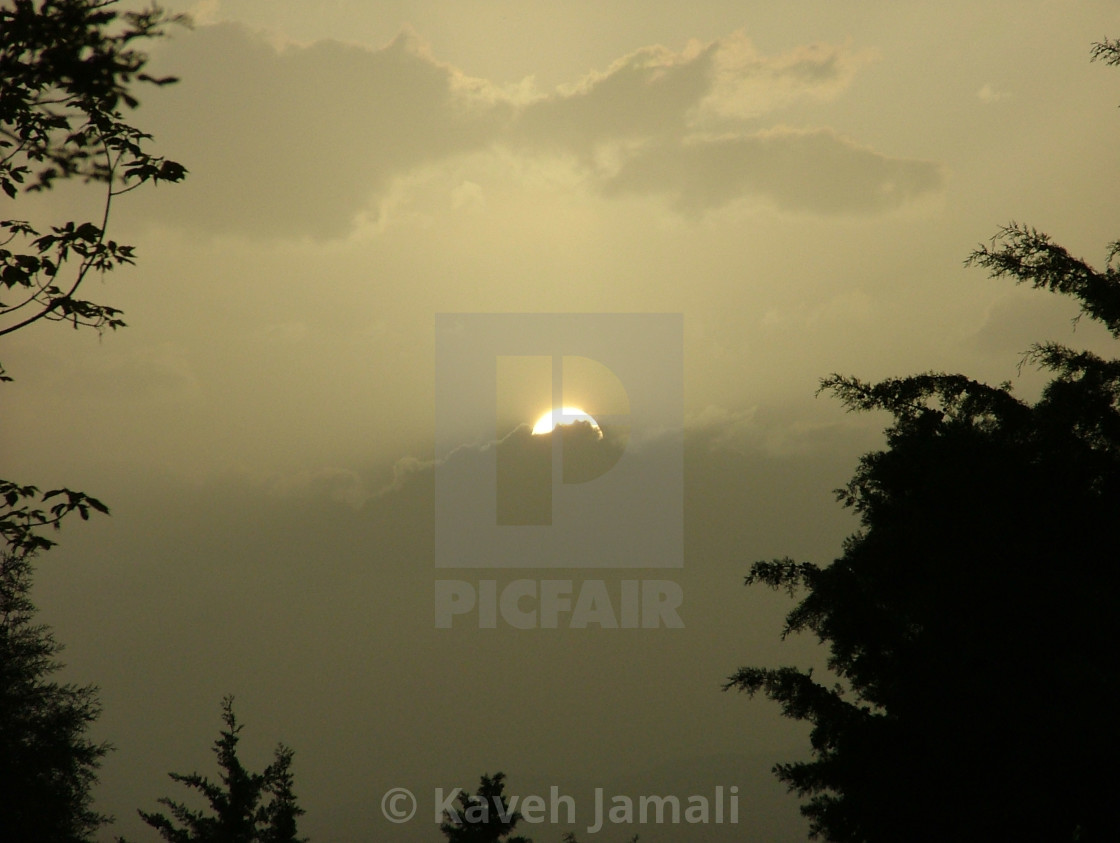"""""""The sun scapes from clouds"""" stock image"""