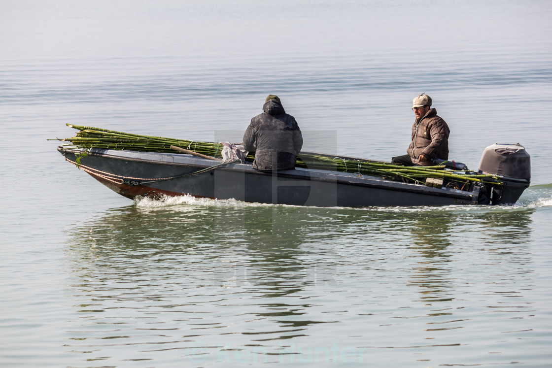"""Two men travelling on Venice lagoon"" stock image"