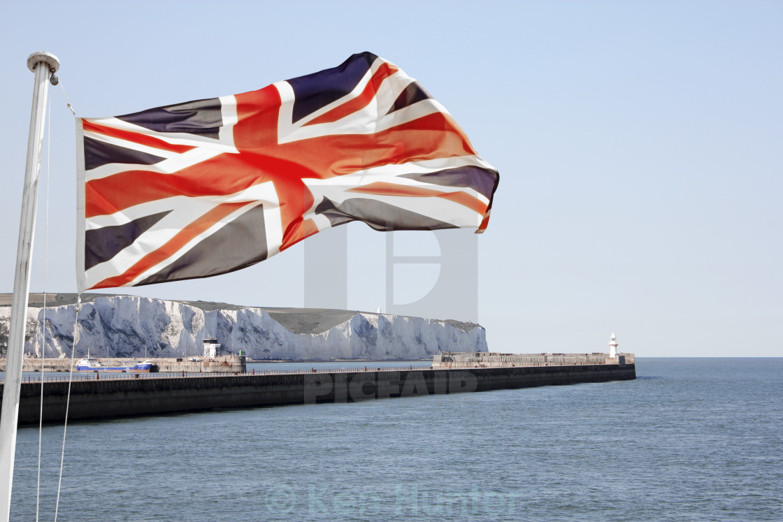 """Union Jack flying over White Cliffs of Dover"" stock image"