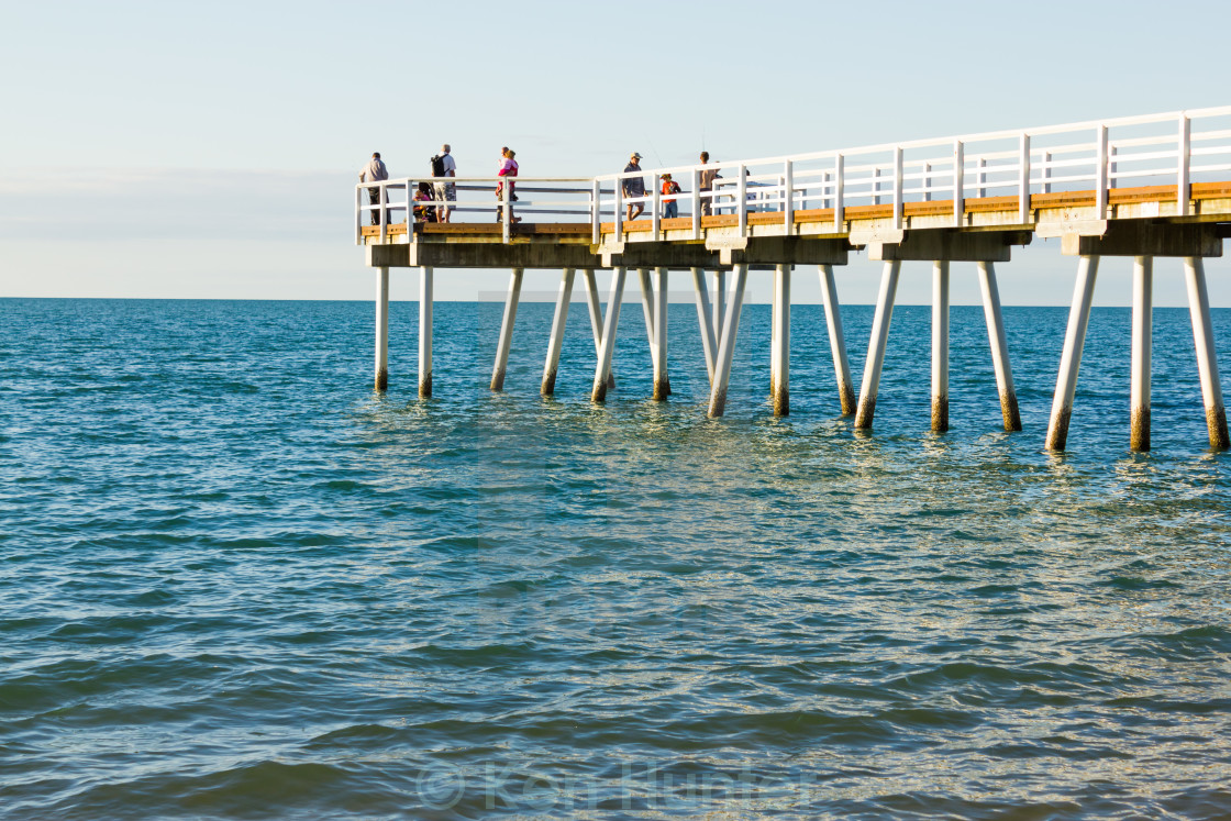 """""""People fishing from pier"""" stock image"""
