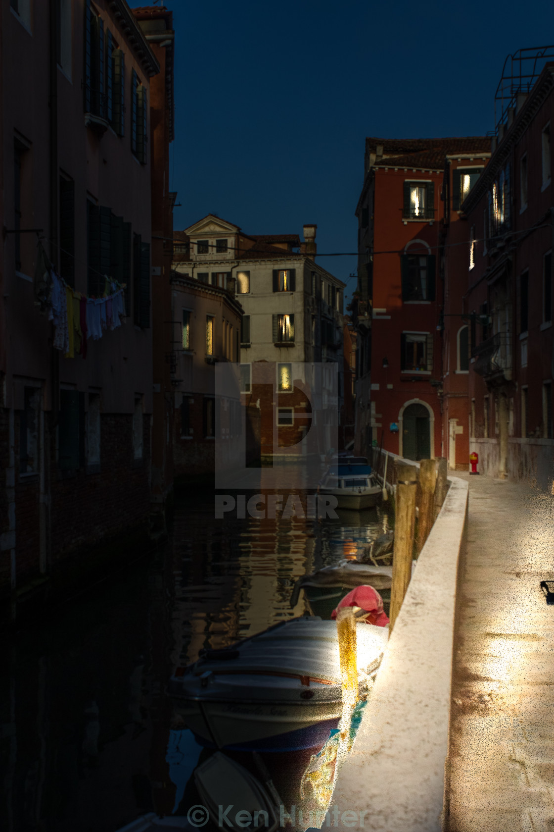 """Venice canal with boats at night."" stock image"