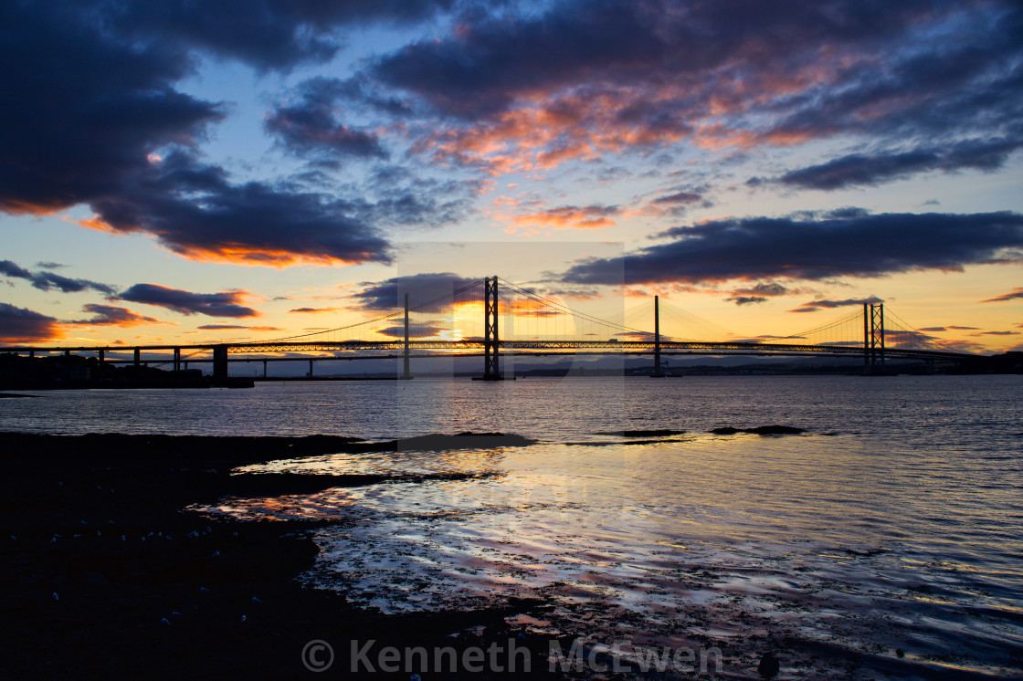 """Sunset behind the Forth road bridges"" stock image"