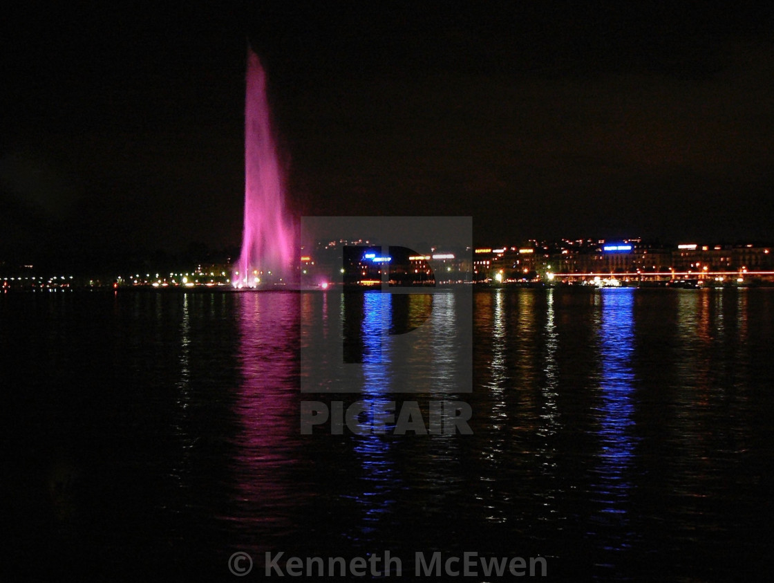 """""""Geneva and the Jet d'eau at night"""" stock image"""