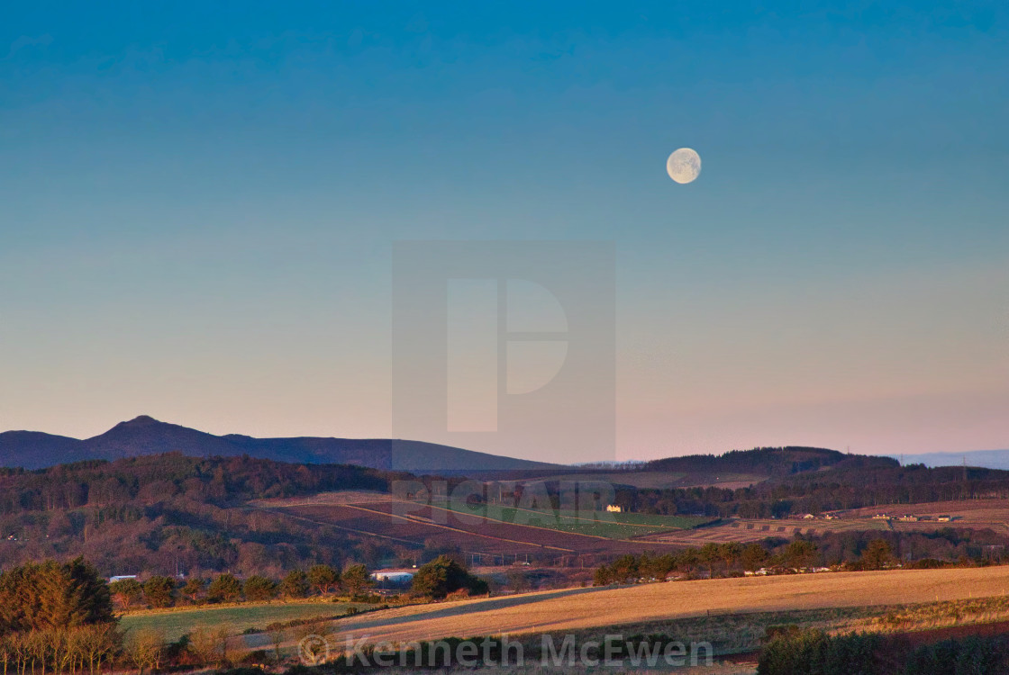 """Bennachie with the moon above"" stock image"