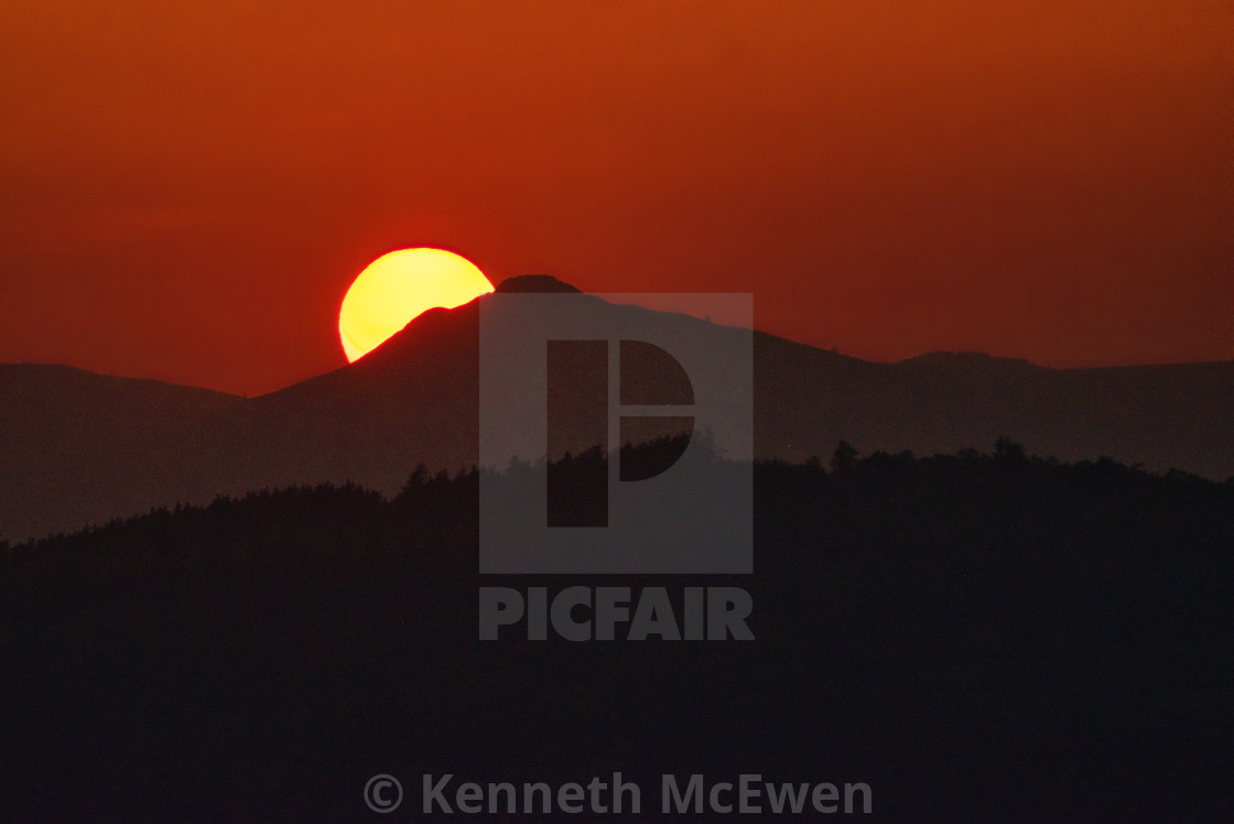 """Sunset behind the Mither Tap on Bennachie"" stock image"