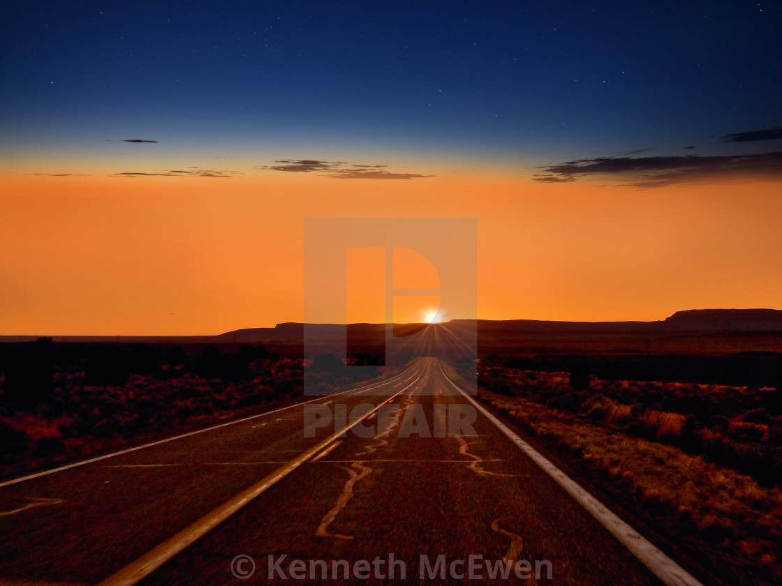 """""""Sunset on a straight road"""" stock image"""