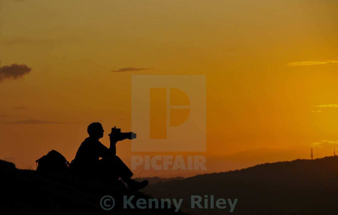 """Photographer at sunset"" stock image"