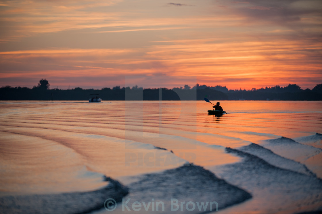 """Kayaker at Sunset"" stock image"