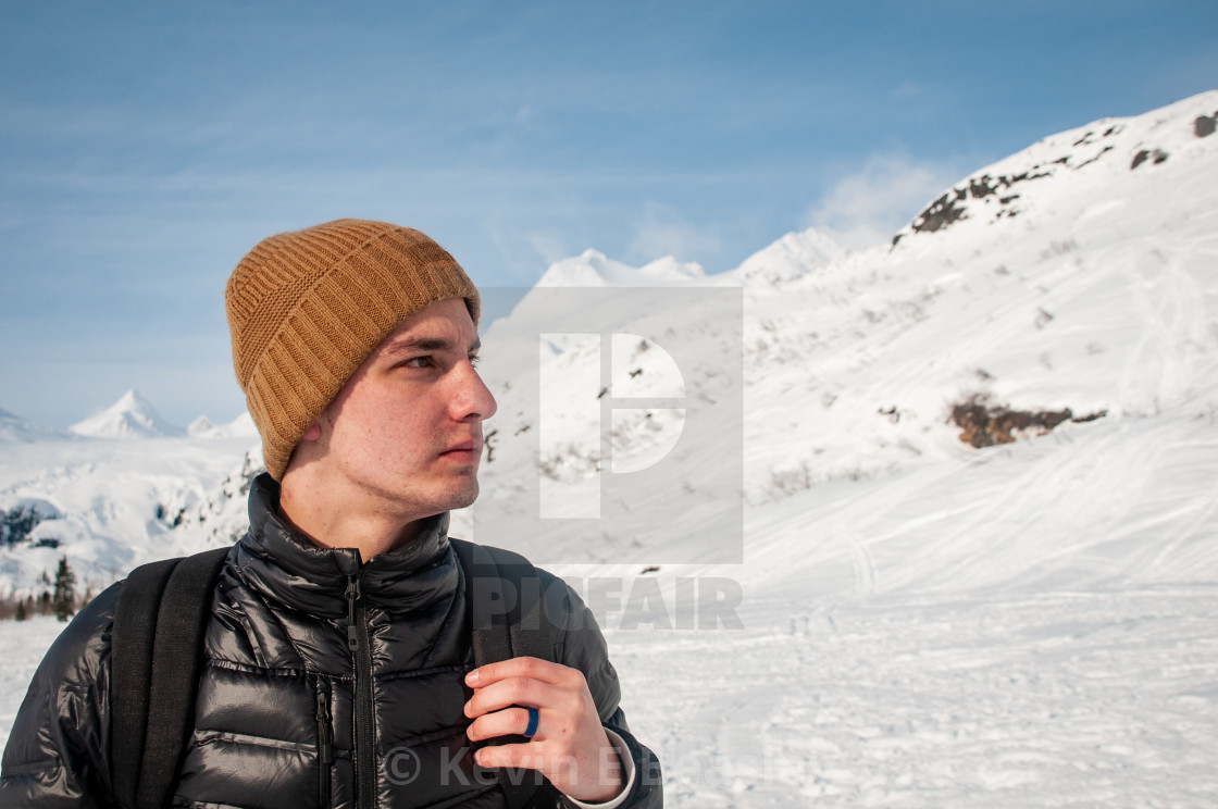 """""""Young Man Hiking in the Alaskan Mountains"""" stock image"""