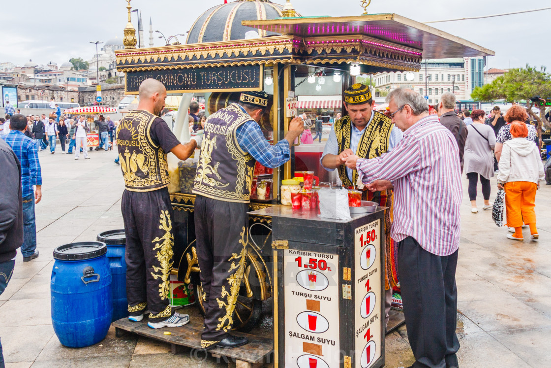 Drinks stall serving customer - License, download or print