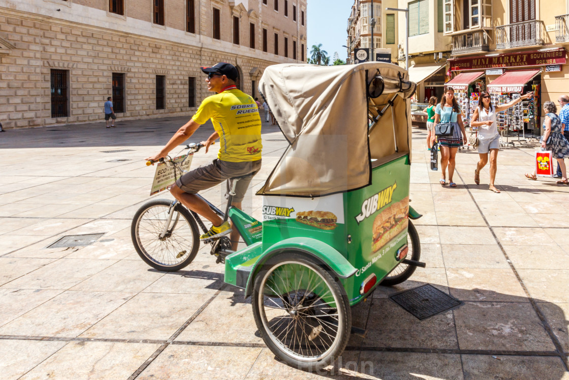 A tricycle taxi looking for business  - License, download or