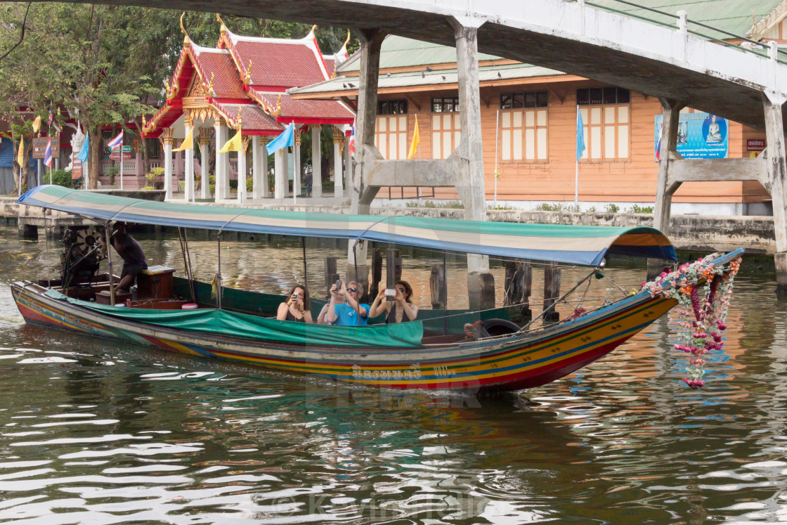 """""""Bangkok, Thailand March 19th 2017: Tourists taking photographs from a boat. A..."""" stock image"""