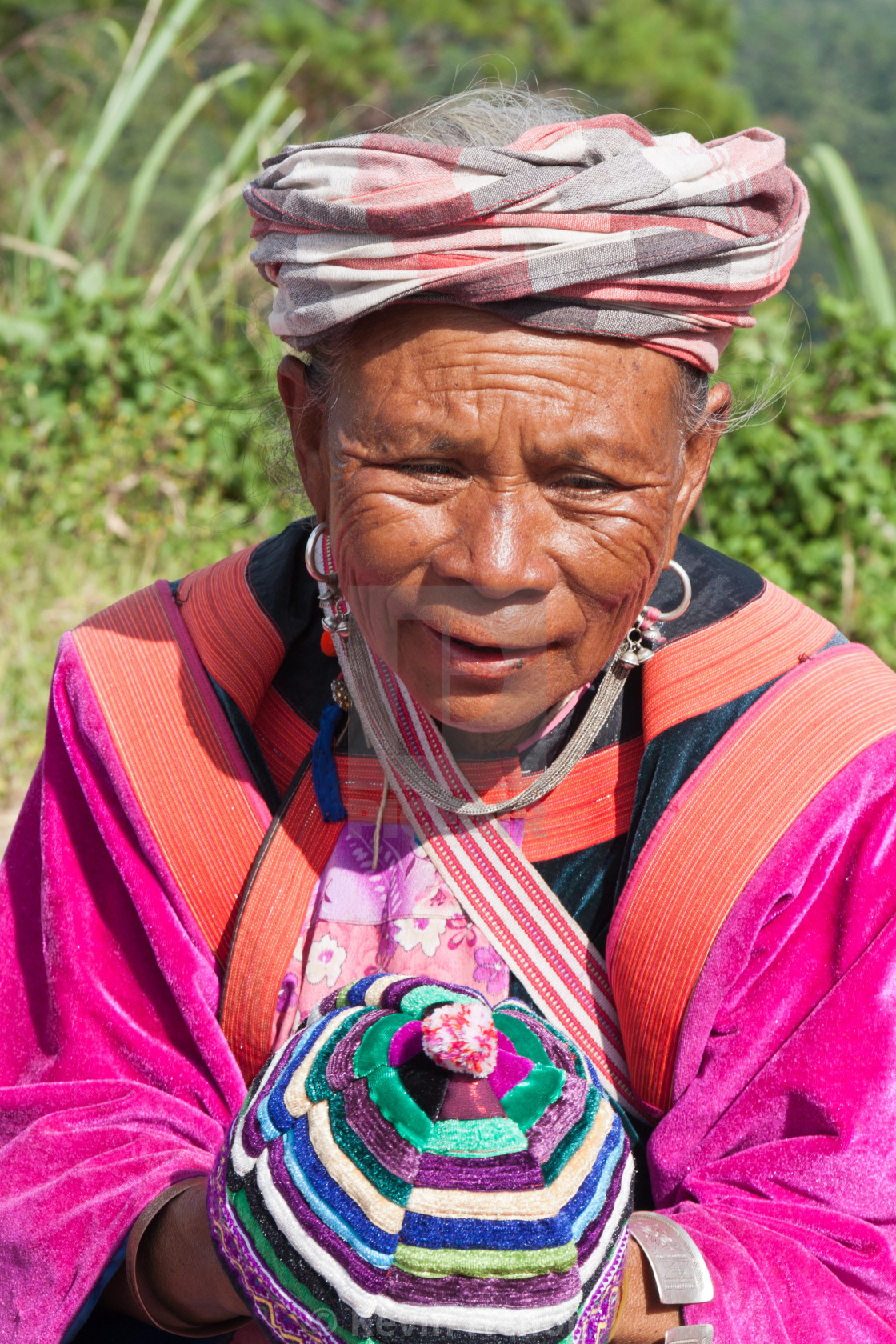 """Lisu woman in traditional dress selling hilltribe hats in Mae Hong Son, Thailand"" stock image"