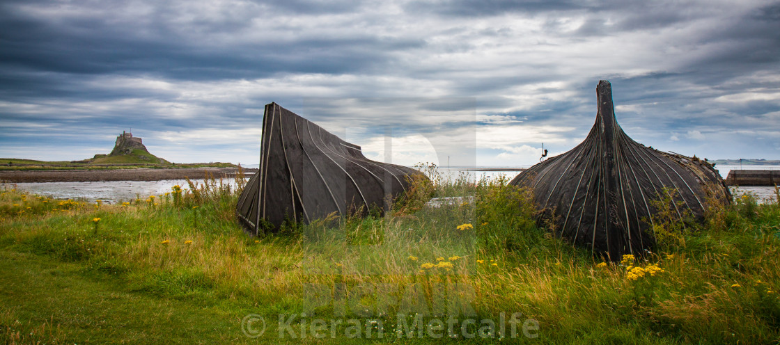 """Lindisfarne Boat Sheds and Castle"" stock image"