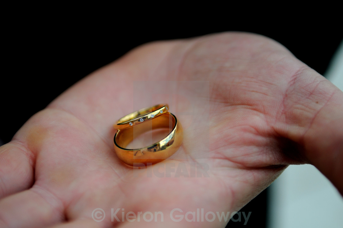 """Gold wedding rings his and hers"" stock image"