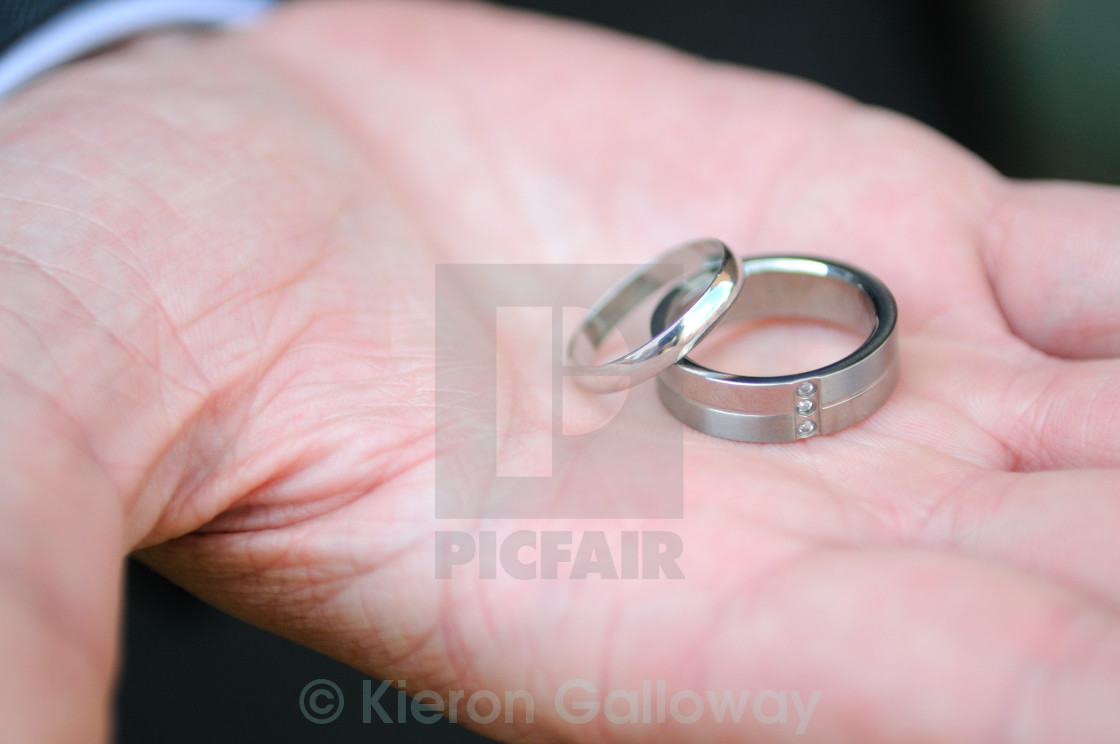 """Platinum wedding rings his and hers"" stock image"
