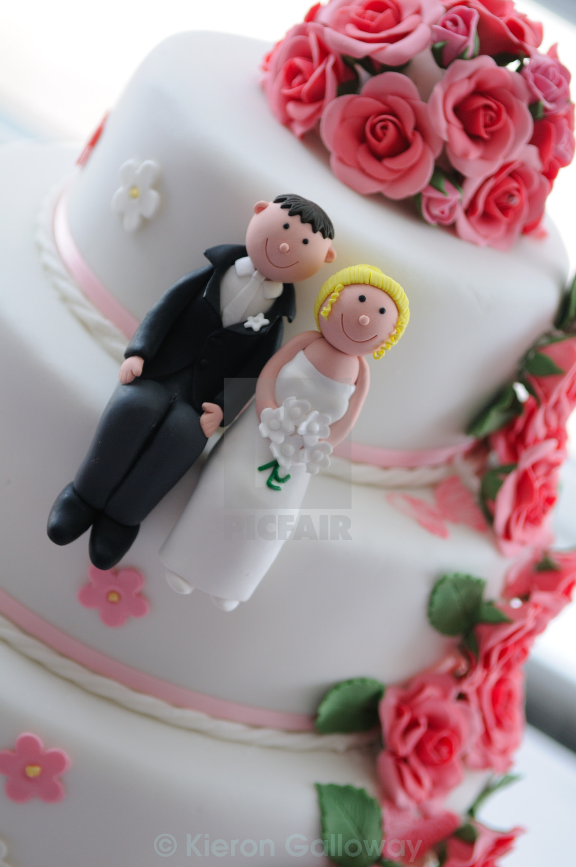 """Wedding cake sugar bride and groom"" stock image"