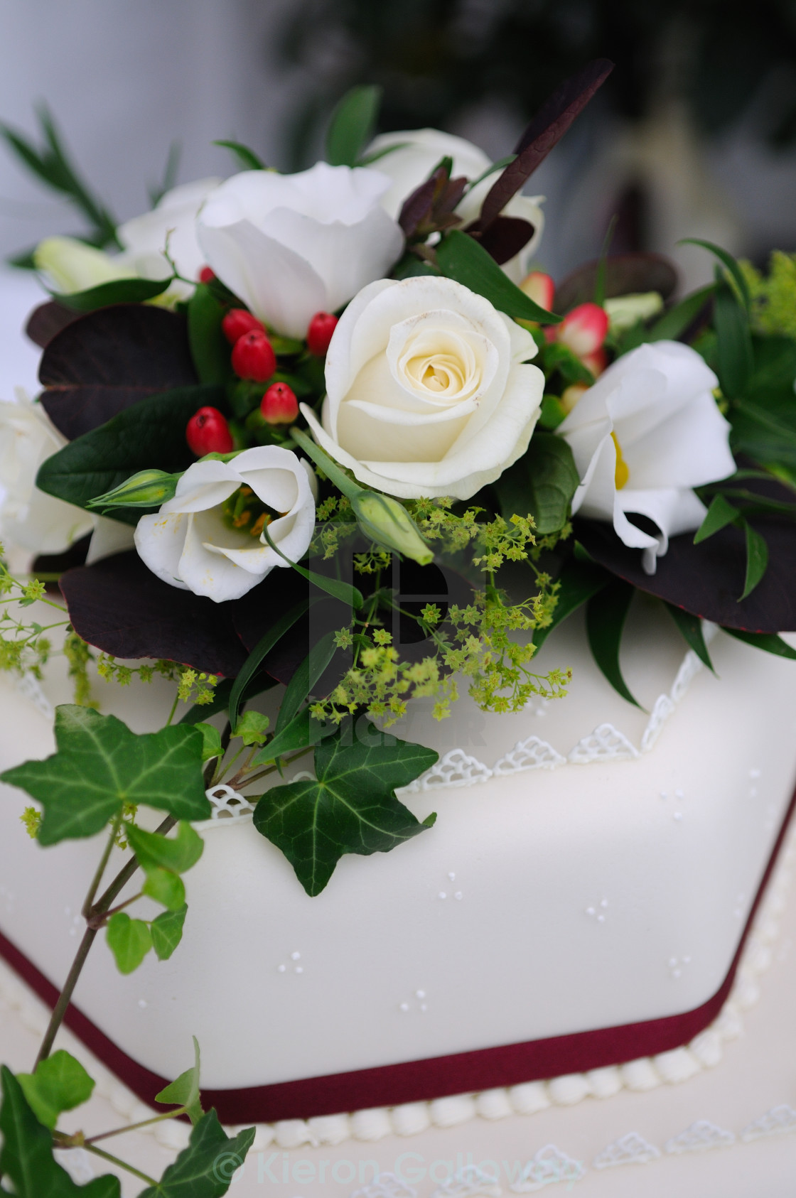 """Wedding cake real flowers white and green"" stock image"