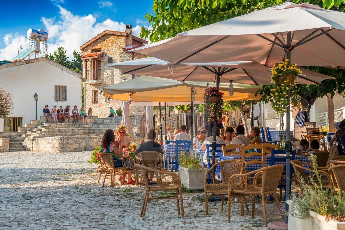 """""""Street cafe's with tourists in Omodos village. Limassol District, Cyprus"""" stock image"""