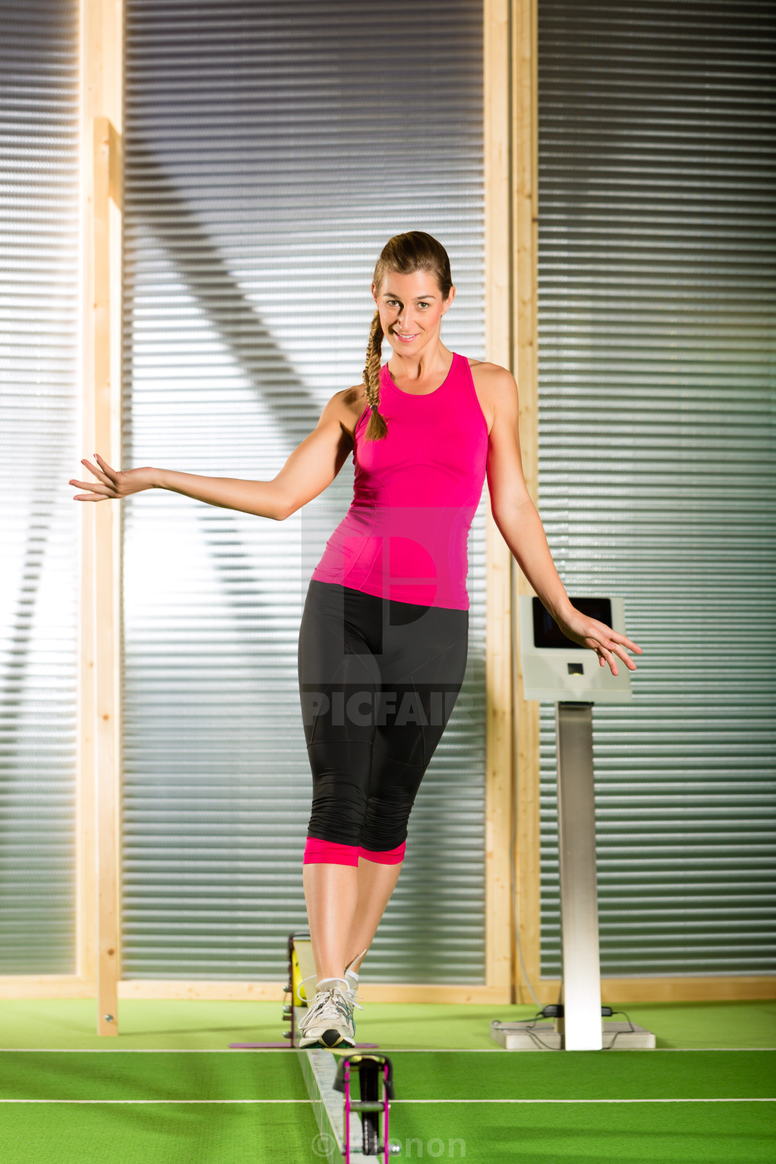 """Woman training with slackline"" stock image"