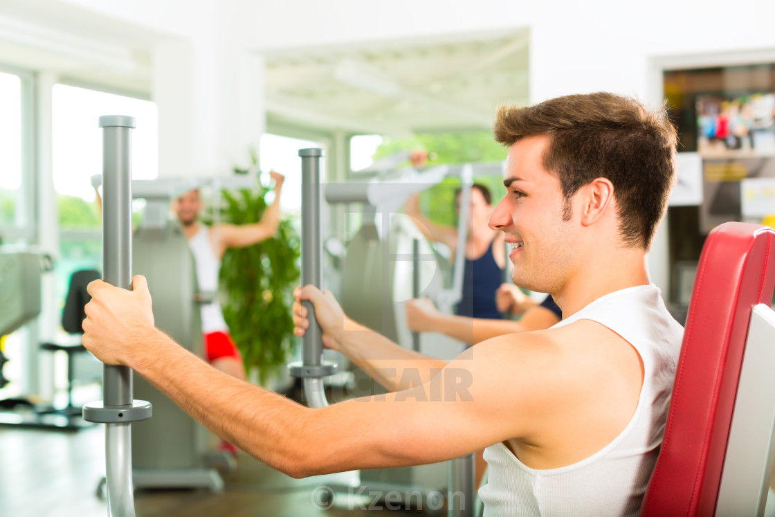 """People in sport gym on the fitness machine"" stock image"
