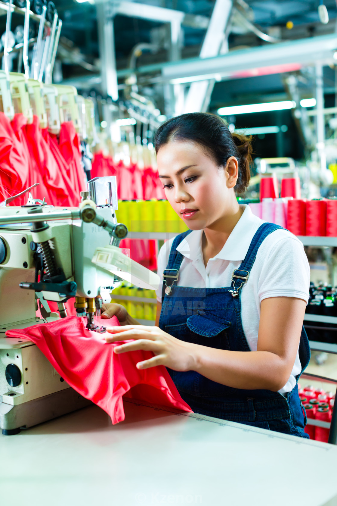 """Chinese seamstress in a textile factory"" stock image"