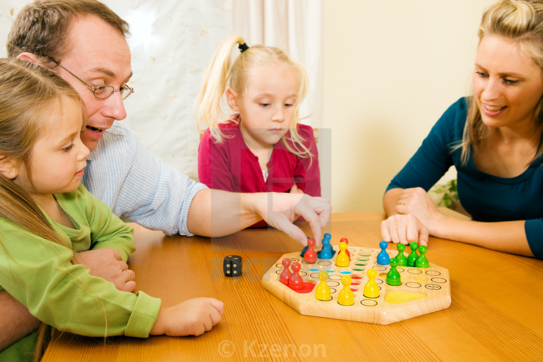 Family is playing ludo together - License, download or print for £12.40    Photos   Picfair