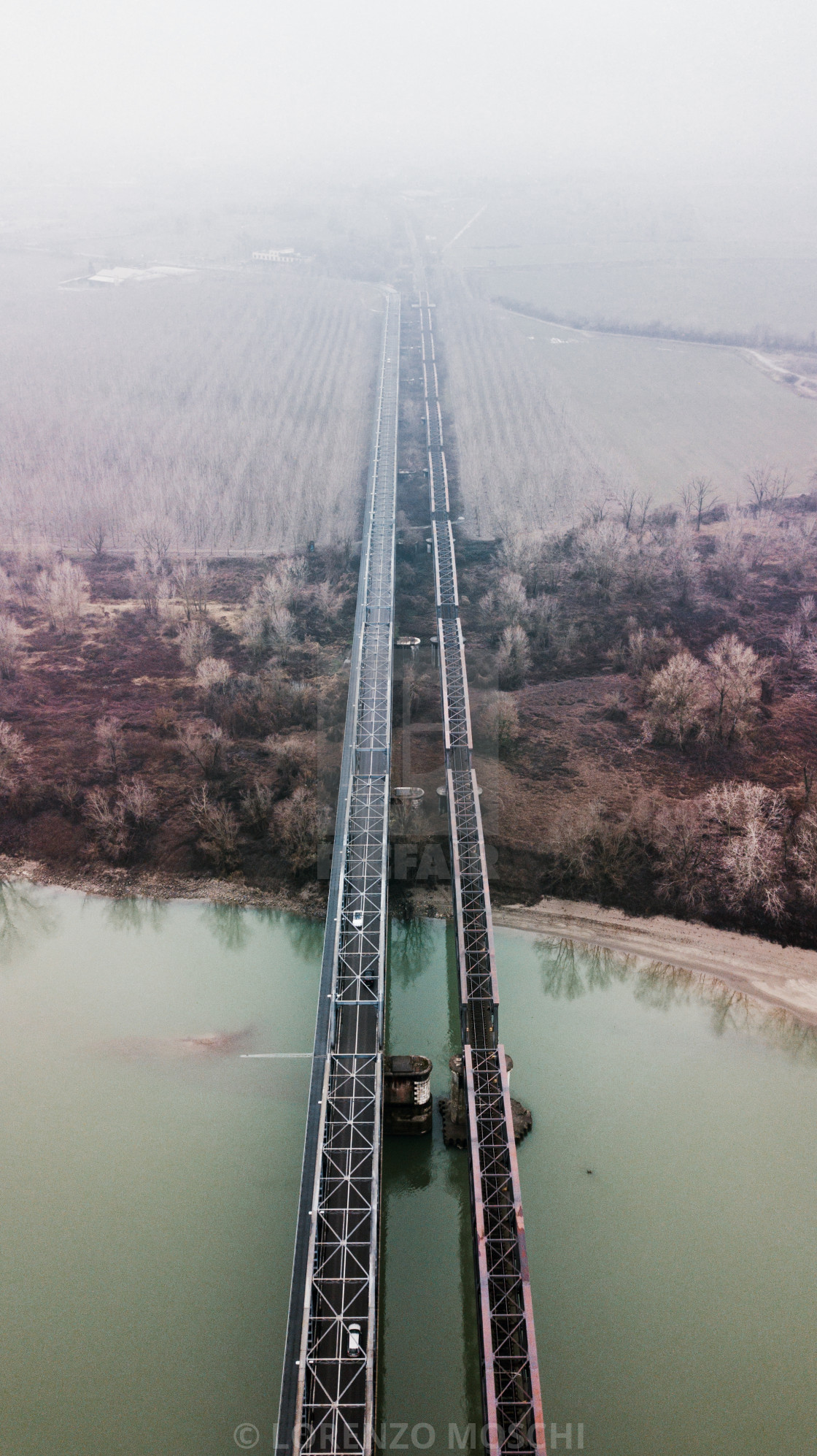 """Aerial view of a bridge in the fog"" stock image"