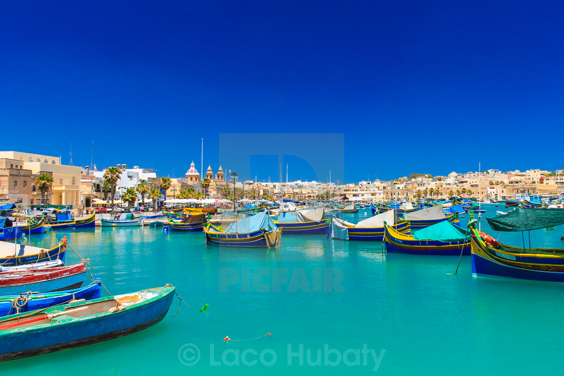 """Boats on turquoise sea"" stock image"