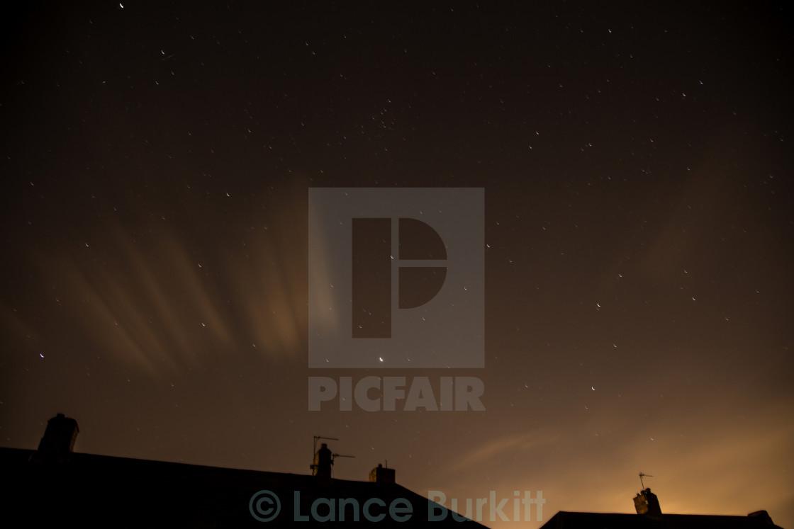 """Orange clouds and stars"" stock image"