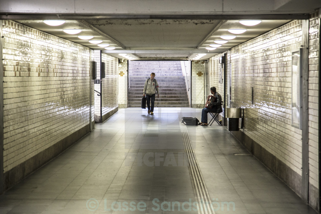 """A musician in empty tunnel"" stock image"