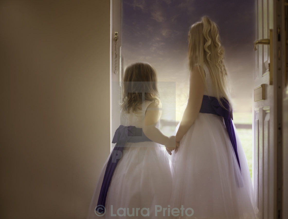 """""""Sisters holding hands"""" stock image"""